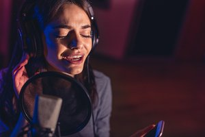 Female singer recording a song