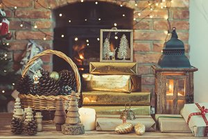 Christmas setting, lantern, decorated fireplace, fur tree