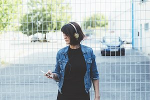 brunette girl with headphones