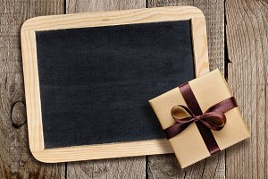 Blackboard and gift box