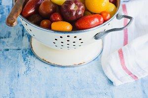 Heirloom tomatoes in enamel colander