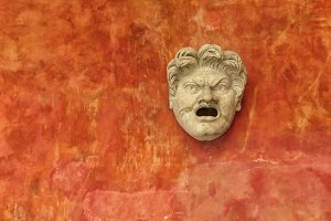Angry stone face of white man
