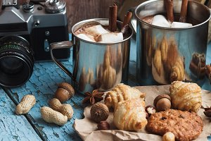 Metal mugs with cacao and marshmallow