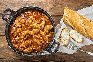 Crubeens with tomato sauce and bread