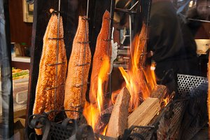 Salmon is smoked on open fire