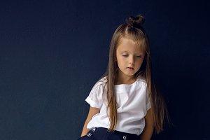 girl in white shirt posing in the studio