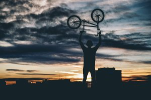 Man poses and practice BMX with bicycle