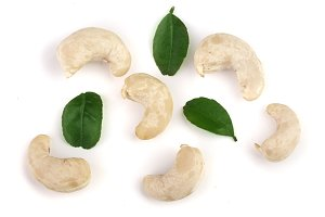 cashew nuts with leaf isolated on white background. top view