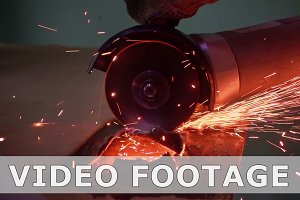 Cutting metal with disc grinder with bright sparks