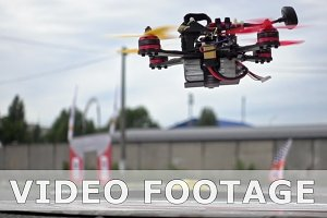 FPV racing drone taking off the ground in slowmo