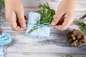 Child wraps Christmas gift