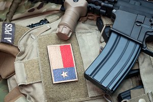 Weapon series - the Black Rifle and the Texas State flag patch on a bulletproof vest