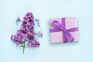 Lilac flowers and gift box