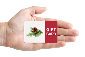 Christmas gift card in hand