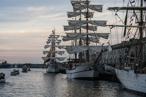 Tall sailing ships in harbor