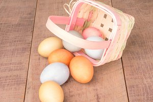 Colorful eggs in wicker basket