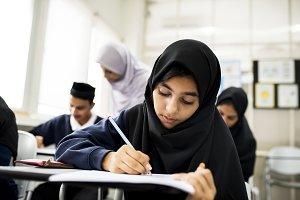 Muslim children studying together