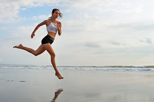 Jogging on the sunset beach