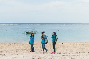BALI, INDONESIA - OCTOBER 8, 2017: Indonesian women on the Pandawa beach, Bali.
