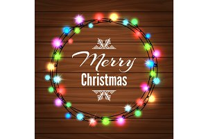 Christmas light garland on wood background