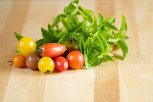 Small tomatoes with basil