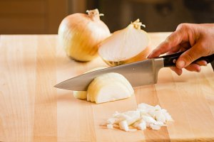 Cook chopping onions