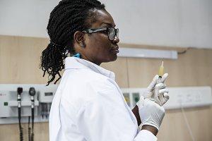 Doctor is preparing a syringe shot