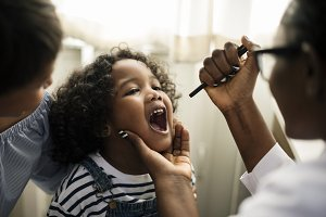 Little girl having her teeth checked