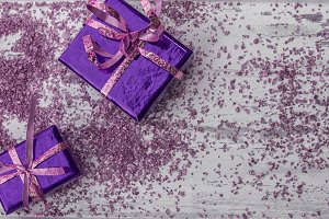 Holiday gifts in purple and pink