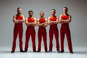The group of gymnastic acrobatic caucasian men