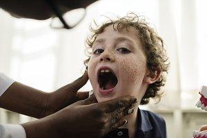 Young boy having his teeth checked