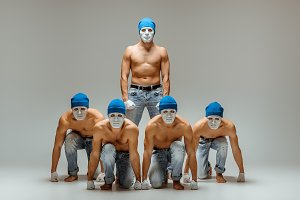 The group of caucasian men in white masks and hats, jeans