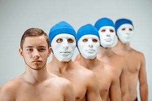 The people in masks and one man without mask