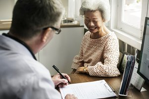 An elderly patient meeting doctor