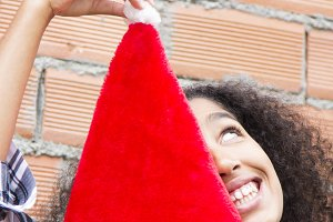 african american girl having fun with santa cap