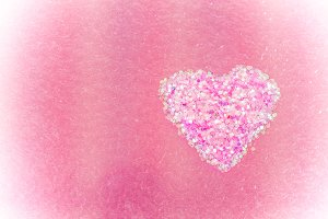 Heart shape on colour background