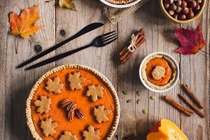 Pumpkin pies on wooden table. Top view. Holiday food