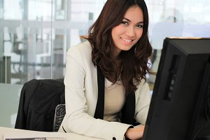 Business woman using a computer