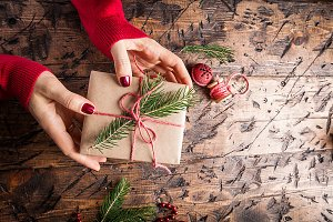 Woman's hands give christmas gift