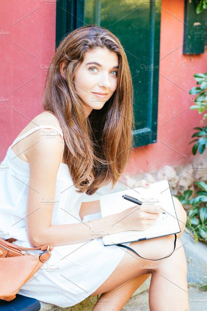 Girl writing.jpg - People