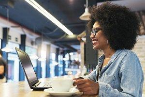 Afro american woman using laptop.