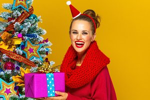 smiling young woman with Christmas present box
