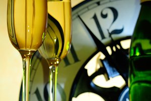 Two glasses with clock background
