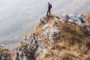 Backpacker man on the edge