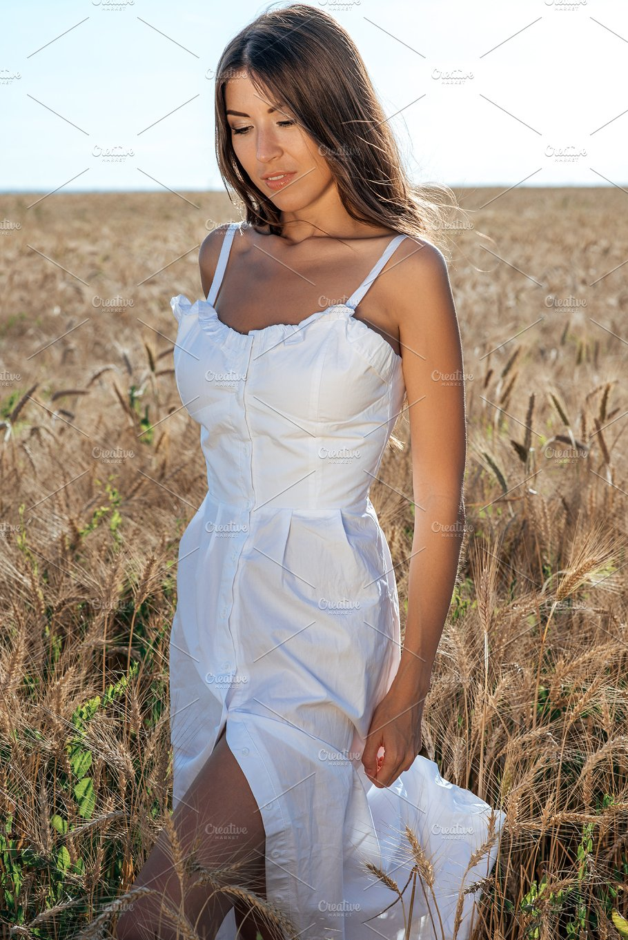 girl in a white dress field wheat outdoor recreation beautiful dress a woman