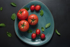 Tomatoes and mint in a plate