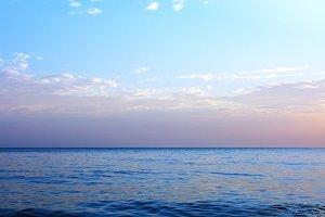 Blue sea ocean horizon sky clouds photo