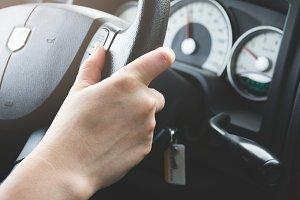 Hands on wheel.