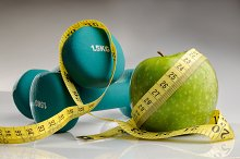 Healthy apple with measuring tape