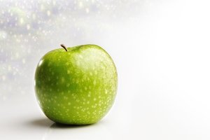 Juicy apple front view, background